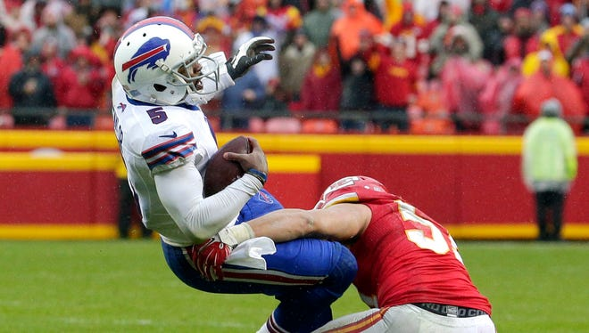 Kansas City Chiefs linebacker Frank Zombo (51) pulls down Buffalo Bills quarterback Tyrod Taylor (5).