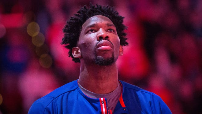 Philadelphia 76ers center Joel Embiid (21) stands for the anthem prior to the start of a game against the Charlotte Hornets at Wells Fargo Center.