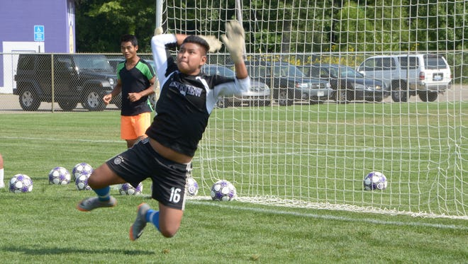 Lakeview goalkeeper Chris Thang leaps to make a save during a dill at the first day of soccer practice on Wednesday.