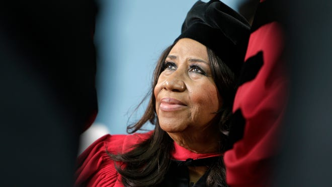 Aretha Franklin looks up while seated on stage during Harvard University commencement ceremonies, in Cambridge, Mass., where she was presented with an honorary Doctor of Arts degree on May 29, 2014.