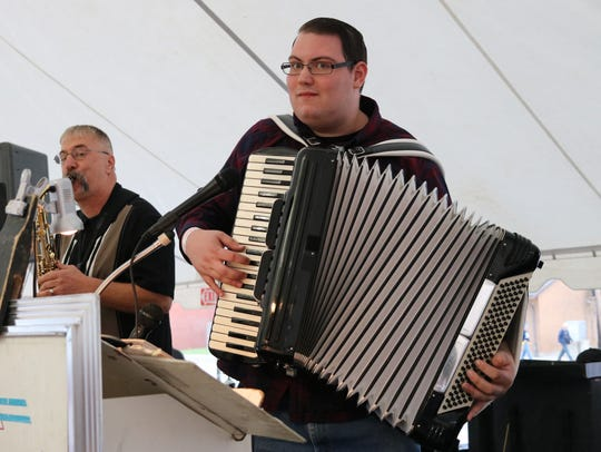 Anthony Culkar's accordion play has patrons at the