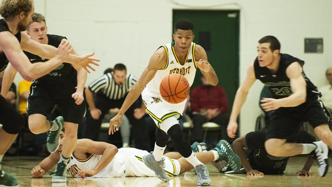 Vermont's Trae Bell-Haynes (2) battles for the loose ball during the men's basketball game between the Dartmouth Big Green and the Vermont Catamounts at Patrick Gym on Wednesday.