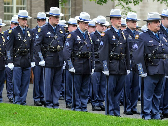 Members of Dutchess County Sheriff's Office stand in formation during the annual memorial service Thursday at department headquarters in Poughkeepsie.