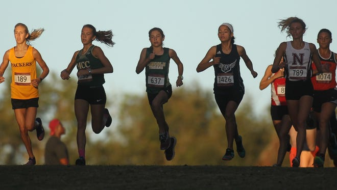 Lincoln freshman Alyson Churchill, third from left, takes off at the start of Saturday's FSU Invitational girls elite race at Apalachee Regional Park. Churchill won in 18:06, beating out Melbourne Central Catholic senior Amanda Beach, second from left.
