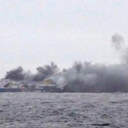 In this photo taken from a nearby ship, smoke rises from the Italian-flagged Norman Atlantic after it caught fire in the Adriatic Sea, on Sunday.