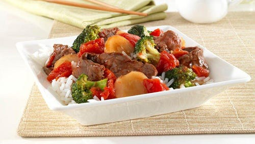 Tomatoes, broccoli and steak in a teriyaki sauce top rice in this fast dinner dish.