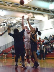 Riverheads' Olivia Modlin shoots in the lane over two