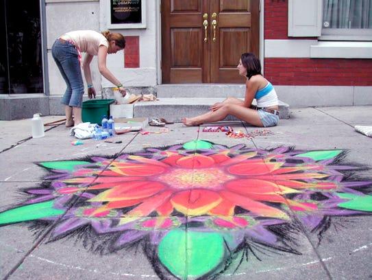 Meghan Duffy and Kathleen Reardon finish their sidewalk