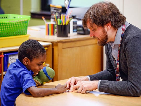 Clarence Farrington School 61 kindergarten teacher Adam Gross pulls student Terrance Hatcher, 6, aside to work with one-on one during class on Thursday, May 4, 2017.