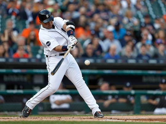 Tigers first baseman Miguel Cabrera (24) hits a double