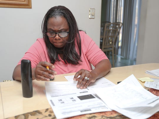 Deloris Ritchie on the phone with New York's Tolls by Mail customer service as she attempts to make sense of her Tolls by Mail bills after the amnesty program at her Hillcrest home on Thursday, April 5, 2018.