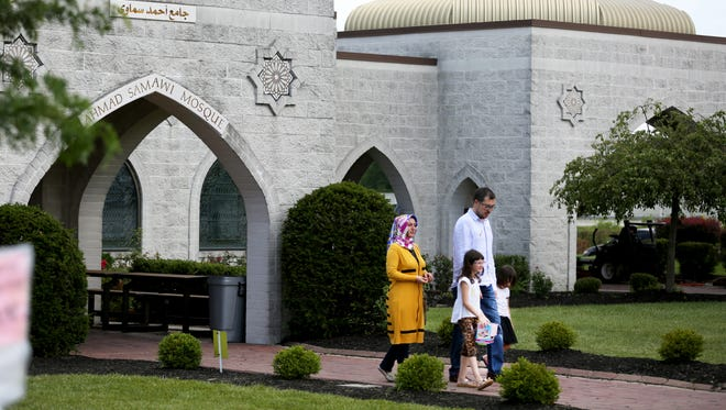 Worshippers leave a prayer service at the Islamic Center of Greater Cincinnati, in West Chester Township.