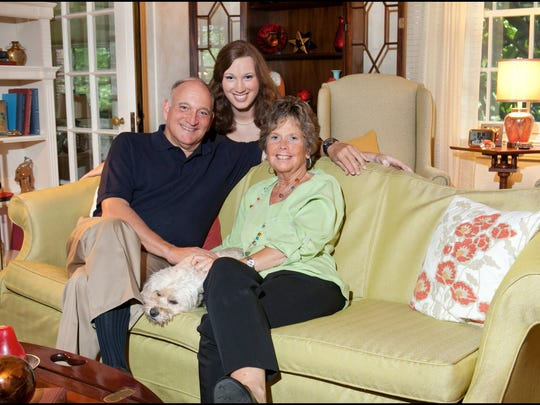 Sarah McBride (middle) with her parents, Dave and Sally.