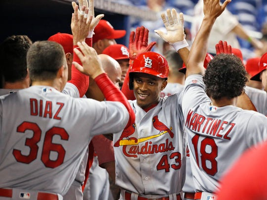 St. Louis Cardinals' Magneuris Sierra (43) is congratulated
