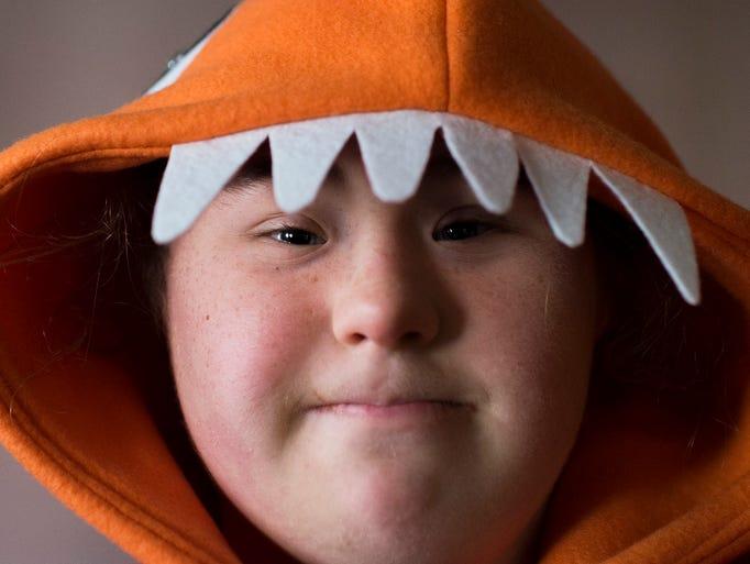 June Ruffenach, 15, wears her dragon themed Mummers