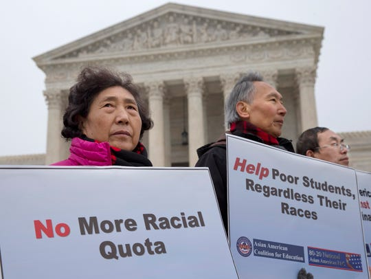 Guixue Zhou of North Potomac, Md., left, and others