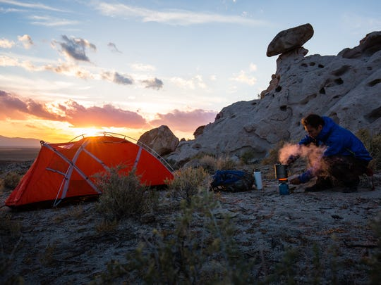 A man camping in this undated photo from Basin and Range National Monument, designated by President Barack Obama in 2015.