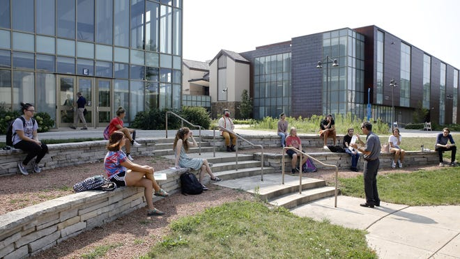 Associate professor David Ross teaches a speech class outside on Monday on the first day of in-person classes for the 2020-21 school year at Rock Valley College in Rockford. The first day of in-person classes was moved from Aug. 17 to Monday after a tornado struck the college's main Mulford Road campus Aug. 10.