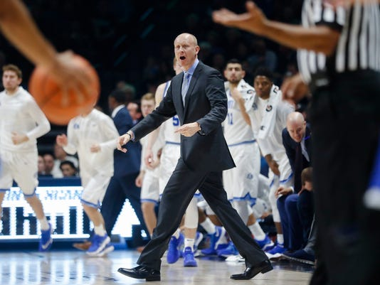 Xavier head coach Chris Mack reacts during a timeout in the first half of an NCAA college basketball game against Creighton, Saturday, Jan. 13, 2018, in Cincinnati. (AP Photo/John Minchillo)