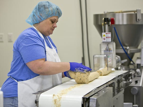 An Elliotts of Montana employee works in the production