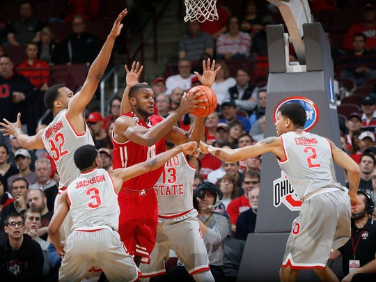 Wisconsin's Vitto Brown is smothered by a group of