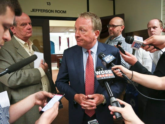 """University of Louisville interim President Greg Postel talks to the media after a special board of trustees meeting where he proposed a separation of the university and its hospital.  """"Health care is evolving rapidly ... and there are a lot of question marks,"""" Postel said."""