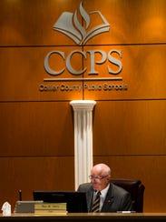 Chairman Roy Terry listens as other board members speak