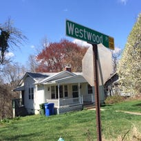 Jerry McKinney splits wood at his home on Westwood Place. It's a great place to live, albeit a little hard to find, McKinney said.