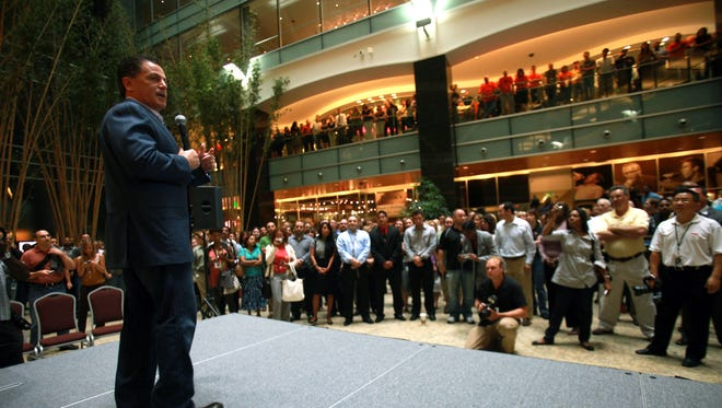 Quicken Loans founder Dan Gilbert addresses a crowd as he and his company are welcomed to Detroit Monday August 16, 2010 during a celebration in the atrium of Compuware.