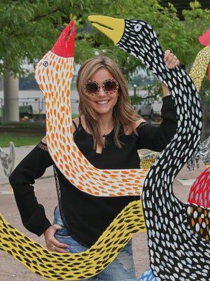 Holly McKnight at the 'The Flock of Finns' sculpture garden at Waterfront park in Louisville, KY. Jun. 29, 2015