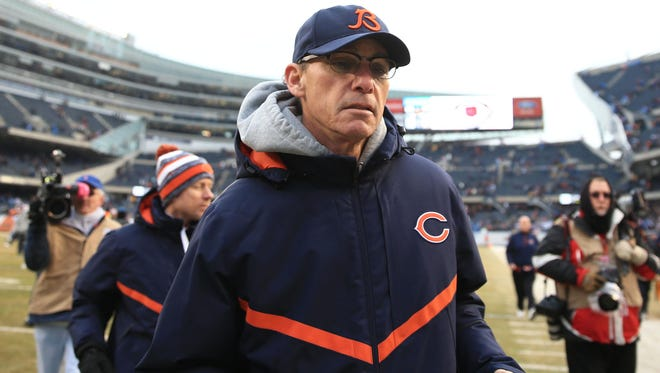 Dec 21, 2014; Chicago, IL, USA; Chicago Bears head coach Marc Trestman runs off the field after being defeated by the Detroit Lions 20-14 at Soldier Field.