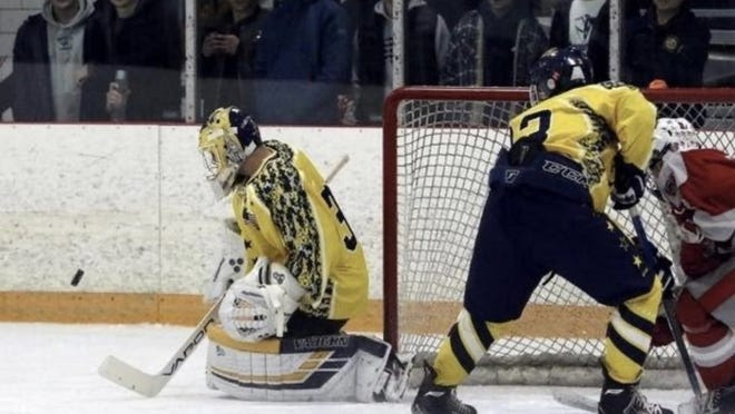 Lexington goalie Donald McCarthy makes a save during a game last winter.