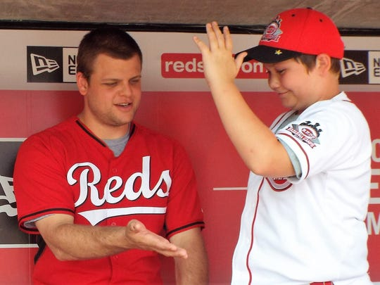 Reds catcher Devin Mesoraco congratulates a camper. An Indianapolis camp is scheduled June 6-10 in Fishers.