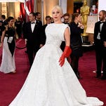 """In this file photo, singer Lady Gaga arrives at the Oscars at the Dolby Theatre in Los Angeles. After dominating at the Oscars, the singer announced she will join the cast of """"American Horror Story."""" FX confirmed on Wednesday  that the pop star will join the fifth season of the hit series, which returns in October."""