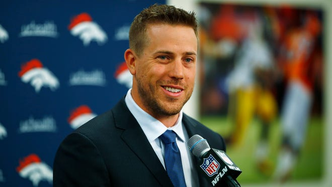 Case Keenum smiles during an NFL football news conference introducing him as the new starting quarterback of the Denver Broncos, Friday, March 16, 2018, at the team's headquarters in Englewood, Colo.