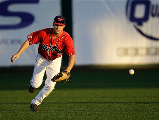 Ole Miss outfielder Auston Bousfield (9) loses the ball in the sun as it hits his glove, allowing a run to score, in the third inning of an NCAA college baseball tournament super regional game against Louisiana Lafayette in Lafayette, La.,Saturday, June 7, 2014. (AP Photo/Gerald Herbert)