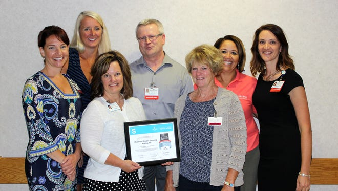 In Fall 2016 McLaren Greater Lansing was recognized by the American Heart Association/American Stroke Association for quality achievement in stroke care. Pictured L to R: Christene Blower, MBA, RN, director of patient experience, Jayne Ward, DO, medical director of stroke and trauma program, Colleen Drolett, RN, stroke and trauma program manager, Kim Hiltunen, cardiac cath lab manager, Lori Shaw, RN, stroke and trauma program nurse, Glenda Cross, RN, director of patient care services and Camille Jensen, MSN, RN, chief nursing officer.