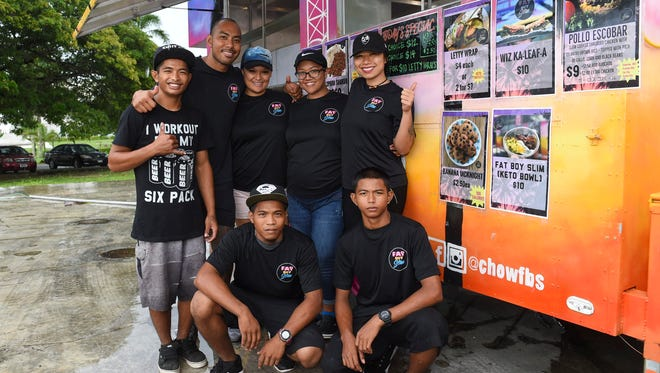 The Fat Boy Slim crew at their food truck in Hagåtña on Oct. 9, 2017. Top row from left: Steve Meno, Ray Chargualaf, Deidre Chargualaf, Sunshine Paet, Vanee Borja. Bottom row from left: Augusto Acfalle and Brandon Acfalle.