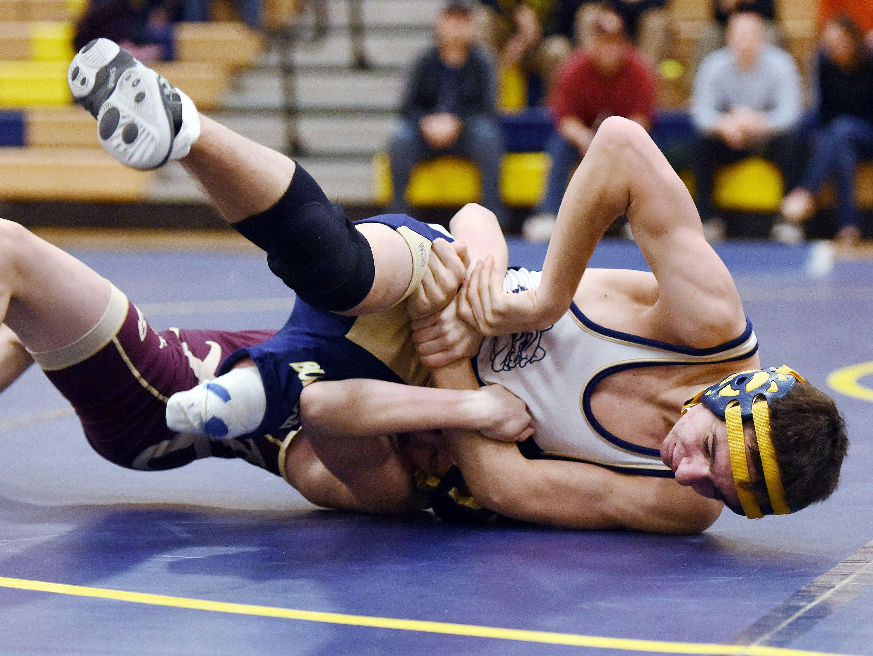 Beacon High School's Liam Ollive, top, wrestles at 99 pounds against Arlington High School's Dennis Robin in December in Beacon.