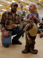 Toby Wright talks to his daughter Charlee Wright Saturday during the San Juan College Halloween Festival in Farmington.