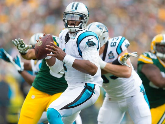 Panthers quarterback Cam Newton scrambles against the Packers on Oct. 19.