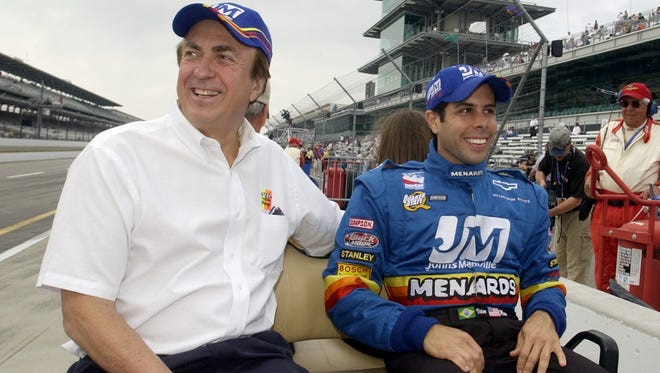 John Menard (left) walked away from IndyCar in 2004. He's back for this Indy 500, partnering with the Penske team. This photo with Vitor Meira was taken in 2003. , taken in 2003 at IMS.