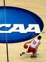 A federal judge denied the NCAA access to records from the college basketball trial, in which three men were convicted for their roles in a widespread pay-to-play recruiting scheme.