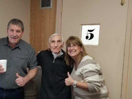 From left: Joe Yanuzzi (center) surrounded by his son, Joe Yanuzzi, and daughter Karen Reardon.