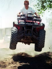 Jonathan Burton, 14, jumps out of a ditch and into
