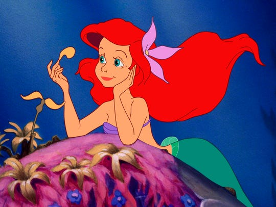 "This image released by Disney shows Ariel, voiced by Jodi Benson, in a scene from ""The Little Mermaid. The film, celebrating its 30th anniversary this year, also had a big role in making Disney into an animation juggernaut. Many believe we'd never have Anna and Elsa from ""Frozen"" without first having Ariel. (Disney via AP) ORG XMIT: NYET116"