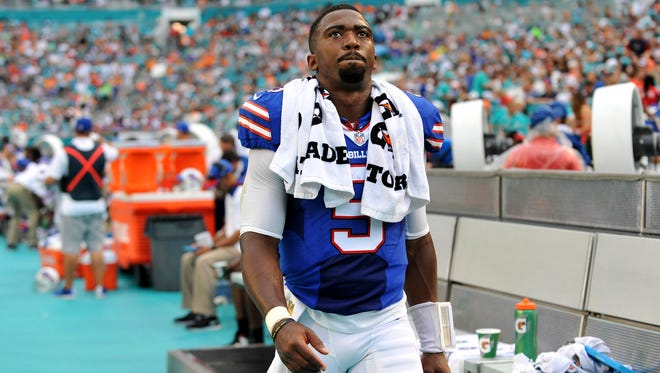 Buffalo Bills quarterback Tyrod Taylor (5) reacts on the sideline during the first half against the Miami Dolphins at Sun Life Stadium.