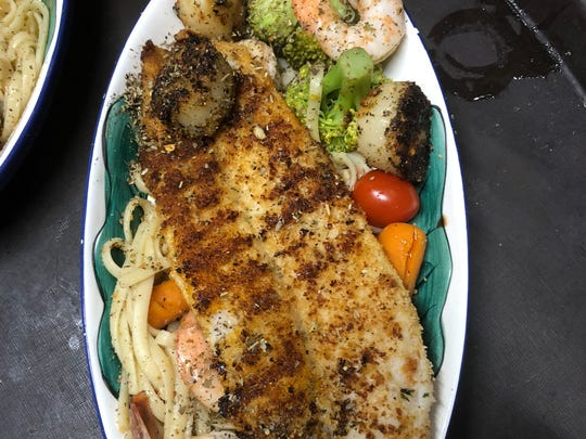 The seafood casserole with salmon, scrod, mussels,