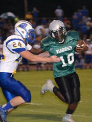 Peabody's Glenn Roberson carries the ball against Buckeye during the Cenla Jamboree at Alexandria Senior High on Friday.