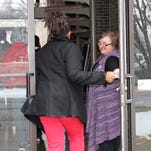 Uspiritus Chaplain Samantha Jewell, right, welcomes a resident to the last service at Salem Church, which Uspiritus recently sold, on March 1.
